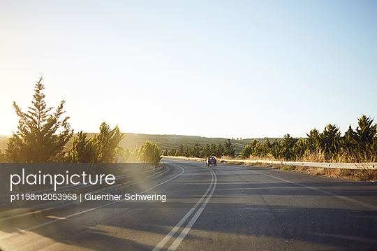 Country road in the sunshine - p1198m2053968 by Guenther Schwering
