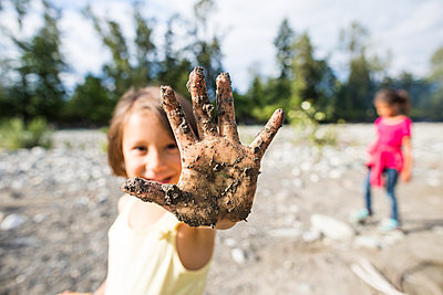 Girl showing dirty hand - p1166m2202021 by Christopher Kimmel / Alpine Edge Photography
