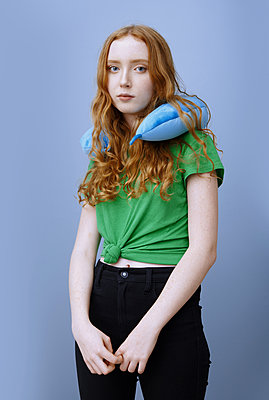 Beautiful teenage girl wearing neck pillow - p1577m2150660 by zhenikeyev