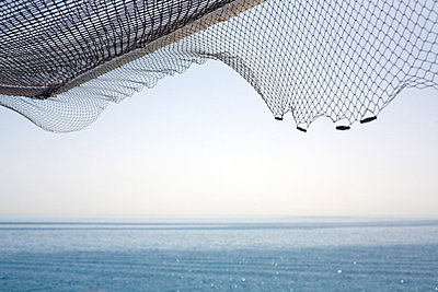 Seascape and fishing net - p3881738 by Ulrike Leyens
