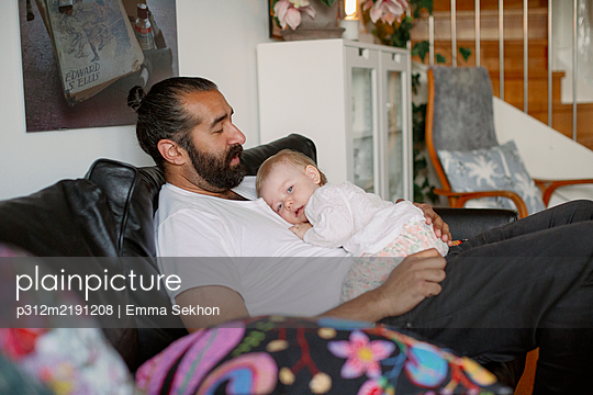 Father with baby - p312m2191208 by Emma Sekhon