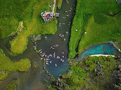 Aerial view of geothermal pool in Iceland - p1166m2201842 by Cavan Images