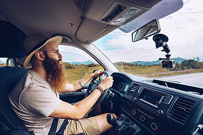 Norway, Lofoten, bearded man driving - p300m2059325 by CSSHOT