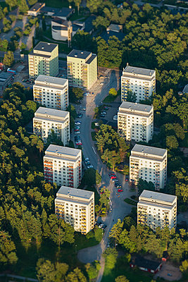 Houses surrounded by trees - p312m1107633f by Hans Berggren