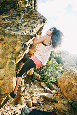 Hispanic woman rock climbing - p555m1302094 by Peathegee Inc
