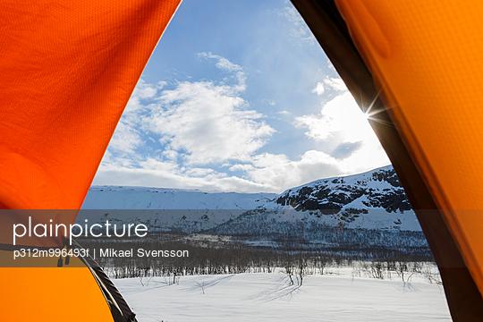 Winter landscape seen through tent entrance
