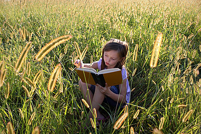 Reading in the cornfield - p1019m739855 by Stephen Carroll
