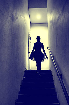 Ballerina going upstairs - p1445m2125927 by Eugenia Kyriakopoulou