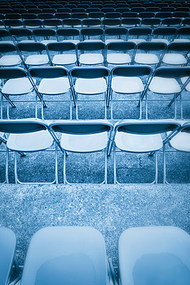 Blue toned black white row chairs grandstand wet - p609m1219854 by OSKARQ
