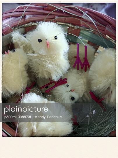 Easter chicks, Easter decoration in a basket, studio