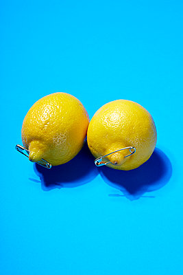 Two lemons with safety pins - p1673m2263482 by Jesse Untracht-Oakner