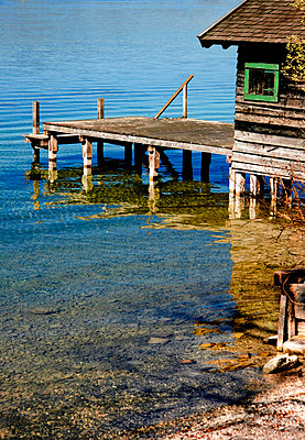 Old boathouse on a lake - p476m1087646 by Ilona Wellmann