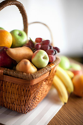 Basket of fruit on table - p924m807336f by Chad Springer