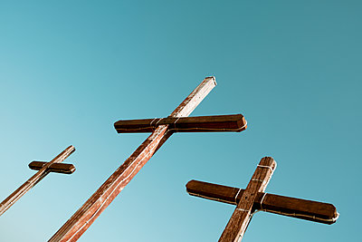 Three wooden crosses against the sky - p1423m2133745 by JUAN MOYANO