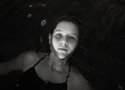 Girl Floating in River - p1503m2015981 by Deb Schwedhelm