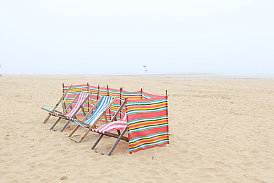 Lonely deck chairs on Margate beach - p1289m2172568 by Elisabeth Blanchet