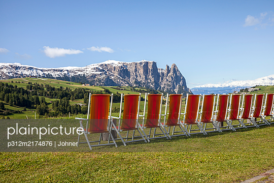 Row of loungers in mountains - p312m2174876 by Marie Linnér