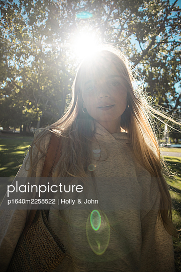 Portrait of teenage girl in the sunshine - p1640m2258522 by Holly & John