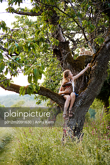 Girl on tree - p312m2091630 by Anna Kern