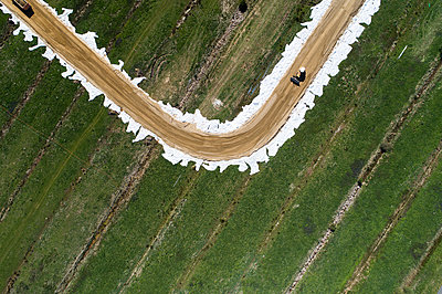 Road works in the countryside, aerial view - p1079m2181982 by Ulrich Mertens