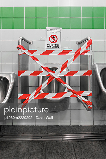 Barrier tape in public urinal for men - p1280m2220202 by Dave Wall