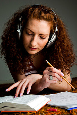 Young woman listening to music - p4130576 by Tuomas Marttila