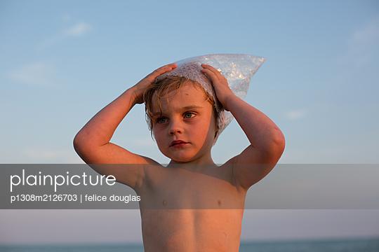 Boy at the beach - p1308m2126703 by felice douglas