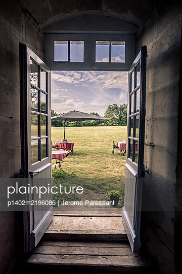 View into garden with set tables  - p1402m2196086 by Jerome Paressant