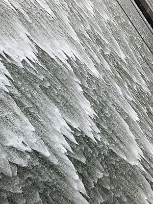 Water flowing over a dam - p1048m2016512 by Mark Wagner