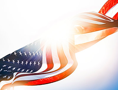 American flag against sunlight - p1427m2292052 by Tom Grill