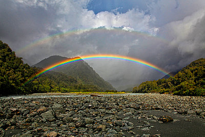 Double rainbow over valley, New Zealand - p343m1585237 by Johnathan Ampersand Esper