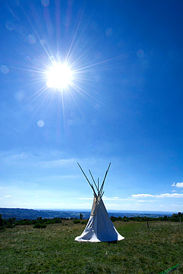 Isolated teepee in a field - p813m924361 by B.Jaubert