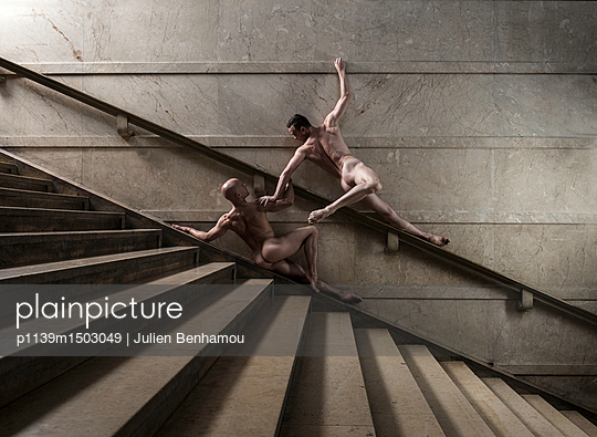Two naked men posing on stairs - p1139m1503049 by Julien Benhamou