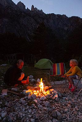 starting a fire - p454m2183633 by Lubitz + Dorner