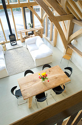 Elevated view of dining table in open plan living area of Devon home - p3493394 by Kim Sayer