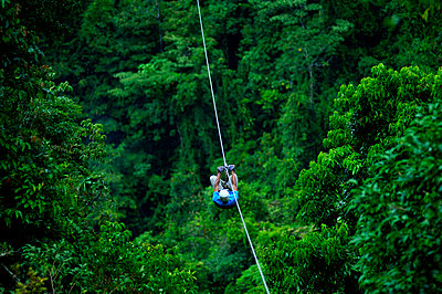 Costa Rica, El Castillo, Tourist Rides The Canopy Zip Line Tour, Rainforest, Arenal - p651m860506 by John Coletti photography