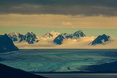 View of glacier and mountain range - p1455m2204524 by Ingmar Wein