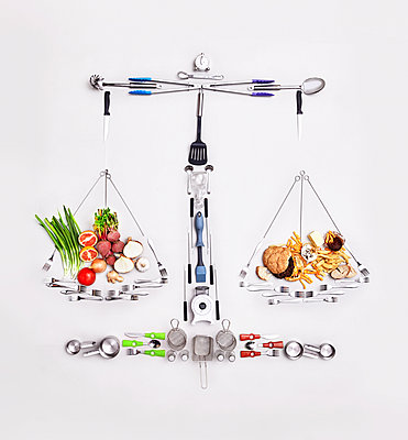 Still life concept healthy and unhealthy foods forming scale - p1023m1226652 by Trevor Adeline