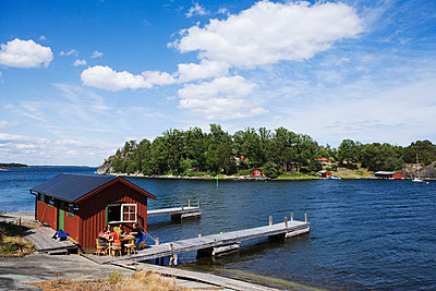 Dinner by a boathouse in the archipelago of Stockholm Sweden. - p31221166f by Conny Fridh