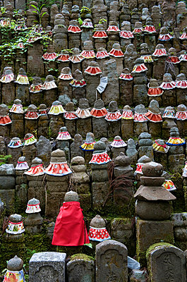 Stone jizo statues with red aprons in the Okunoin Temple cemetery at Koyasan (Mount Koya), Wakayama, Japan, Asia - p8713603 by Photo Japan