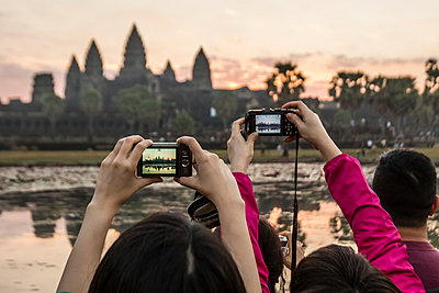 Tourists photographing the sunrise over the west entrance to Angkor Wat, Angkor, UNESCO World Heritage Site, Siem Reap, Cambodia, Indochina, Southeast Asia, Asia - p871m1011646f by Michael Nolan