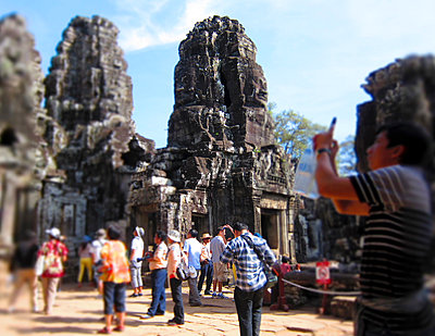 Tourists photographing and admiring the ancient Angkor ruins, Siem Reap, Cambodia, Southeast Asia - p934m893245 by Arno Baude photography