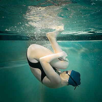 young woman athlete swimming on swim team and posing in dress - p1554m2272605 by Tina Gutierrez