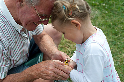 Little girl and her grandfather with butterfly - p7630015 by co-o-peration