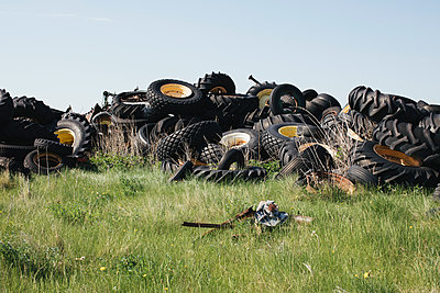 Pile of discarded auto and tractor tires in rural landfill, near Kildeer, Saskatchewan, Canada. - p1100m2002401 by Mint Images