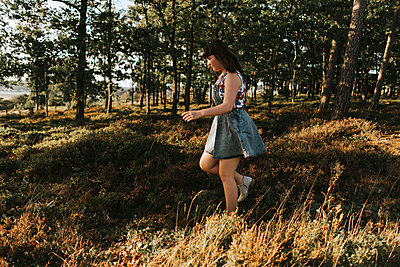 Girl in denim dress - p1507m2165756 by Emma Grann