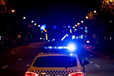 Police patrol car in the streets of Madrid Spain. - p1166m2073701 by Cavan Images