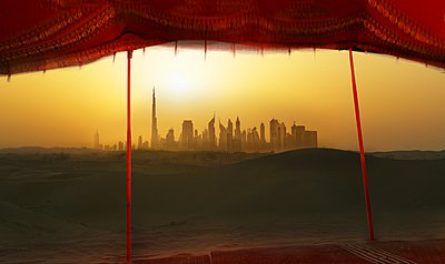 Futuristic cityscape from bedouin tent, Dubai, United Arab Emirates - p429m1021848f by Lost Horizon Images