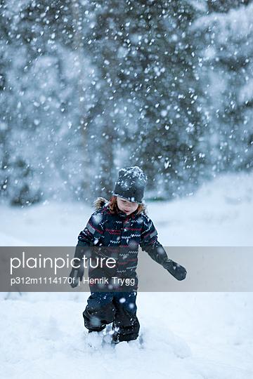 Boy walking at winter