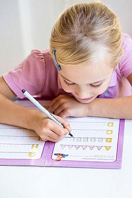Little girl writing alphabet - p300m2012621 by Jana Fernow